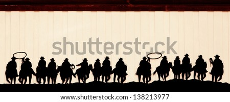 Group of cowboys on horses in vintage style - stock photo
