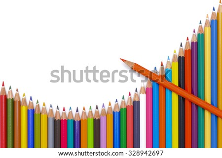 group of crayons show chart with success - stock photo
