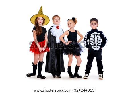 Group of cute children wearing halloween costumes posing over white background. Halloween concept. Isolated over white.  - stock photo