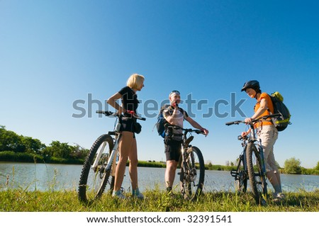 group of cyclists at sunset - stock photo