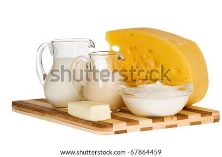 Group of dairy milk products ingredients on wood board isolated on white - stock photo