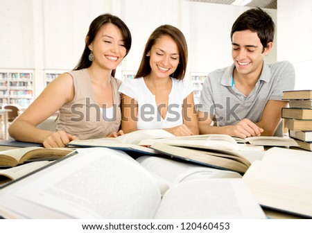 Group of dedicated students working as a team - stock photo