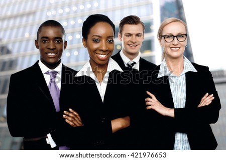 Group of dedicated young business people posing outdoor - stock photo