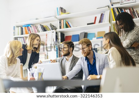 Group of designers discussing trends and future projects - stock photo