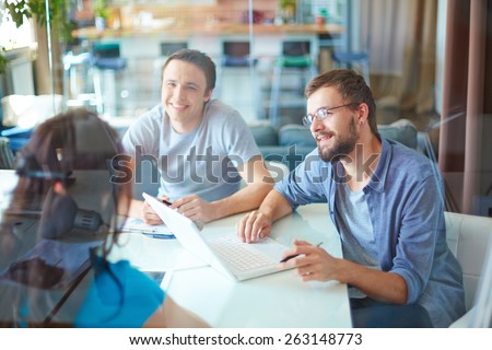 Group of designers meeting in office - stock photo