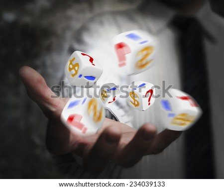 group of dices emitted from businessman hand with dollar sign, exclamation point, question mark - stock photo
