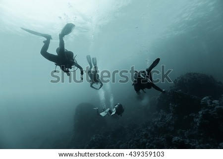 group of divers passing exams open water - stock photo