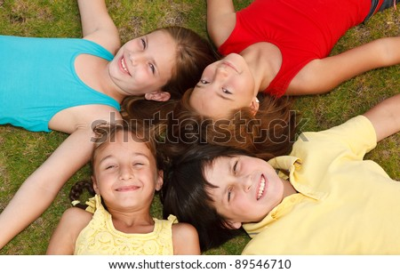group of diverse children playing outside. - stock photo
