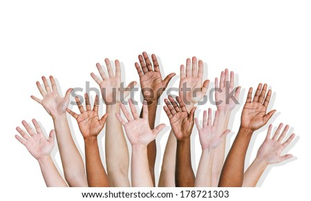 Group of Diverse Hands Raised - stock photo