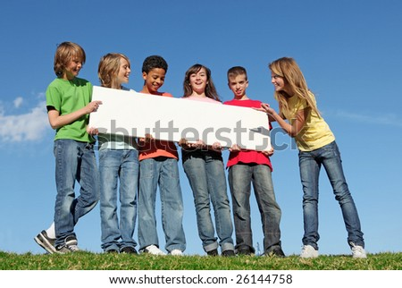 group of diverse kids holding blank sign - stock photo