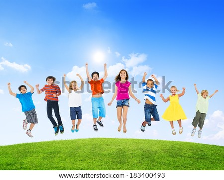 Group of Diverse Multi-Ethinc Children Jumping Outdoors - stock photo