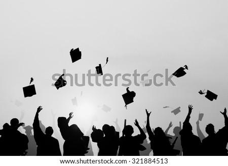 Group Of Diverse Students Celebrating Graduation - stock photo