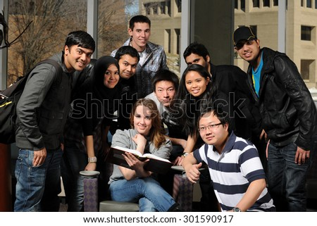 Group of diverse students inside college campus - stock photo