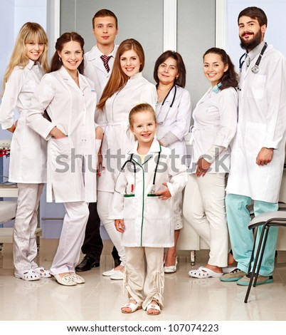 Group of doctor and child at hospital. - stock photo