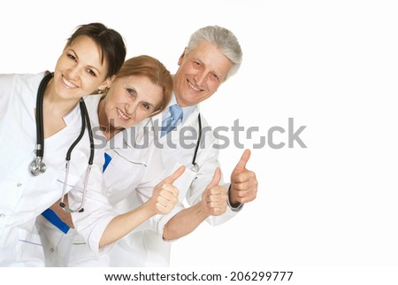 Group of doctors standing on a white background - stock photo