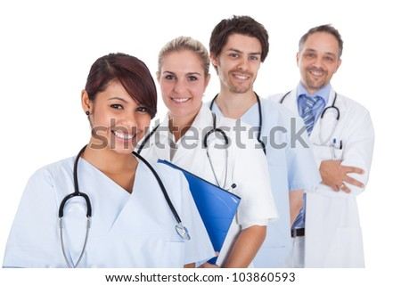 Group of doctors standing together isolated over white background - stock photo