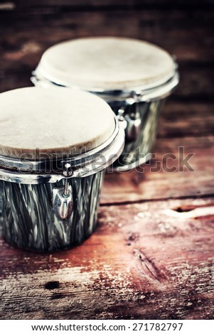 group of  drums on dark wooden background - stock photo
