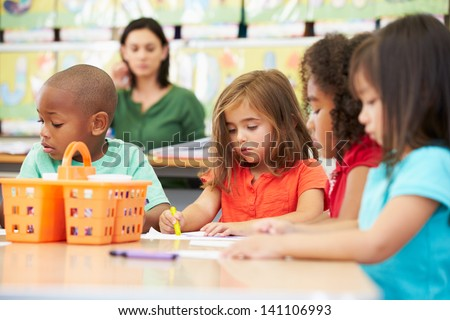 Group Of Elementary Age Children In Art Class With Teacher - stock photo
