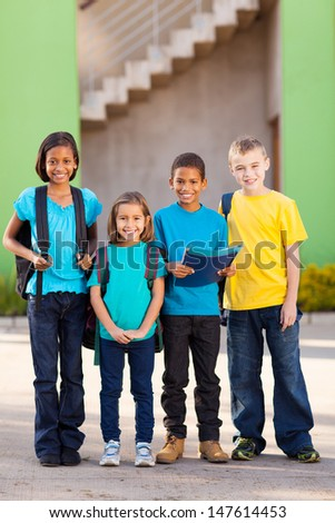 group of elementary school students standing outdoors - stock photo