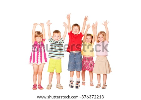 Group of emotional children friends with their hands raised.  Isolated on white background - stock photo