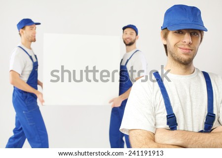 Group of employees holding a blank block - stock photo