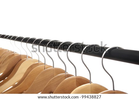 Group of empty wooden coat hangers  row on a white background - stock photo