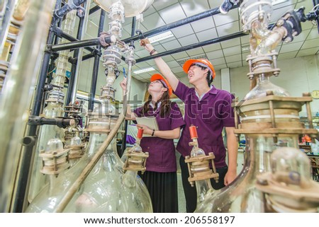 Group of engineer students university looking in machine in laboratory - stock photo