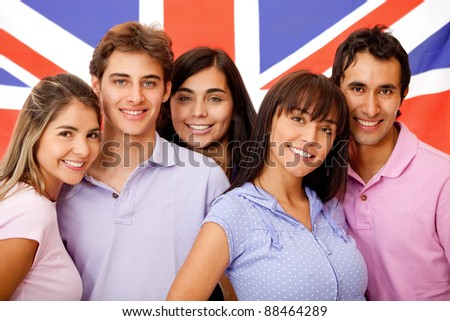 Group of English students with the British flag at the background - stock photo
