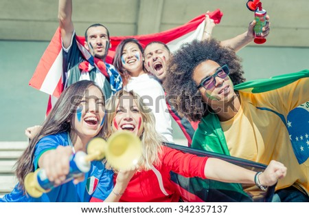 Group of fans supporting their teams at the arena. Sport and fun - stock photo