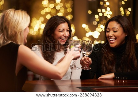 Group Of Female Friends Enjoying Evening Drinks In Bar - stock photo