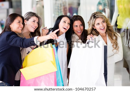 Group of female friends having fun shopping - stock photo