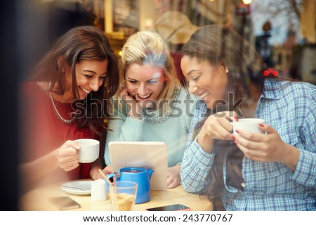 Group Of Female Friends In Caf�¢?? Using Digital Devices - stock photo