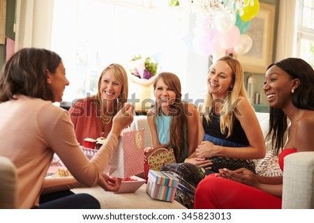 Group Of Female Friends Meeting For Baby Shower At Home - stock photo