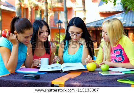 group of female students study for the exam, outdoors - stock photo
