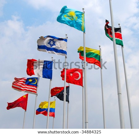 Group of flags against cloudy sky - stock photo