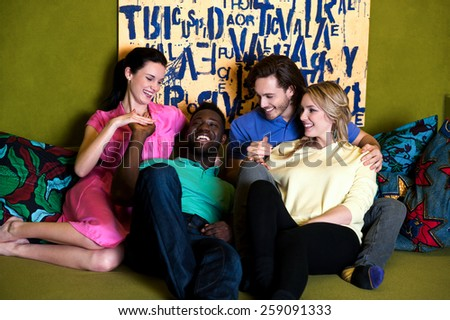 Group of four friends having fun at home - stock photo