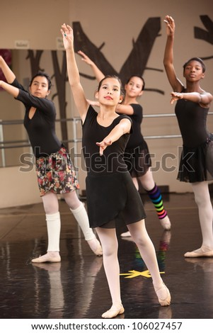 Group of four young Black and Latina dance students - stock photo