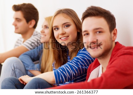 Group of four young people indoors, selective focus - stock photo