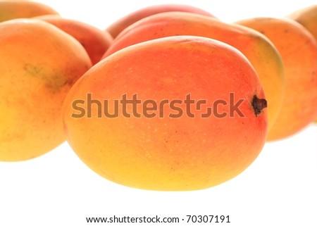 group of fresh mangoes isolated over white - stock photo