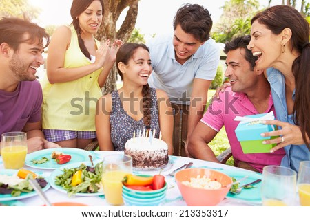 Group Of Friends Celebrating Birthday At Home - stock photo