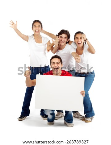 Group of friends cheering holding blank board - stock photo