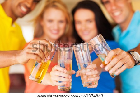 group of friends cheers with drinks - stock photo