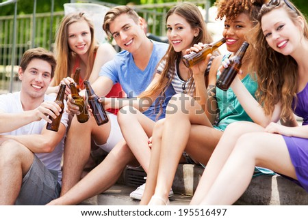Group of friends drinking beer - stock photo