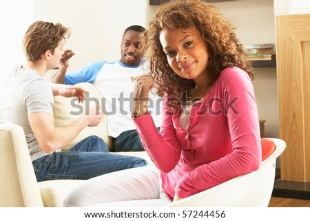 Group Of  Friends Enjoying Chatting Together At Home - stock photo