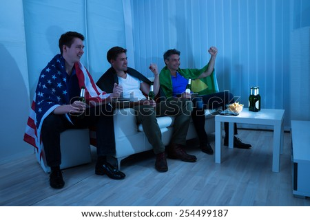 Group Of Friends From Different Nations Enjoying Match - stock photo