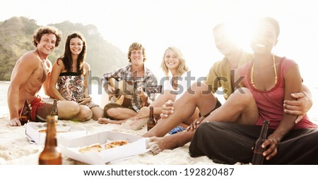 Group of friends having a Beach Party. - stock photo