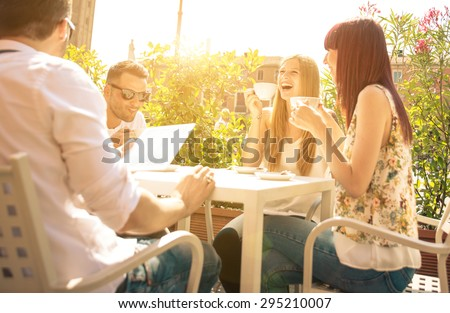 group of friends having a coffee outdoor and having fun. concept about friendship and people - stock photo