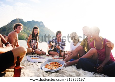 Group of friends having a summer beach party Concept - stock photo