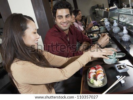 Group of friends having food together at restaurant - stock photo