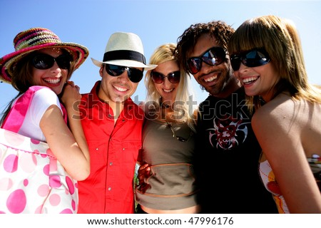 Group of  friends having fun during summer - stock photo